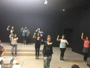 Choreographer Candace Rickman leading dance auditions